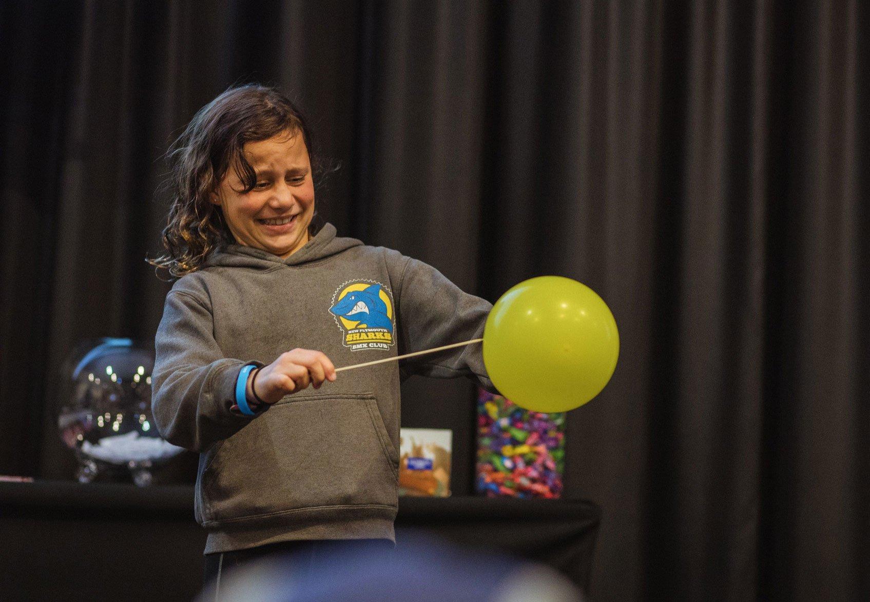 Child Playing with Superhero Science Sticks